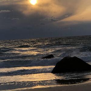 dark sea and sun